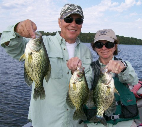 Professional fishing guide Charlie Worrath with happy crappie fishing clients