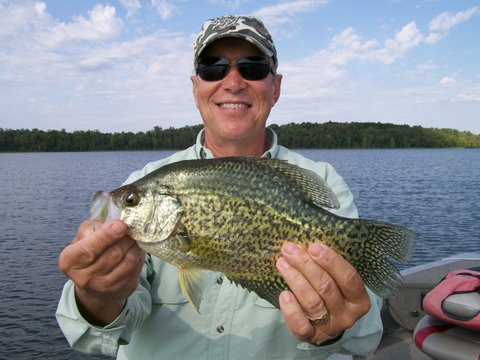 Fishing guide Charlie Worrath with happy crappie fishing client