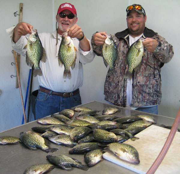 Fishing guide Charlie Worrath clients with crappie haul
