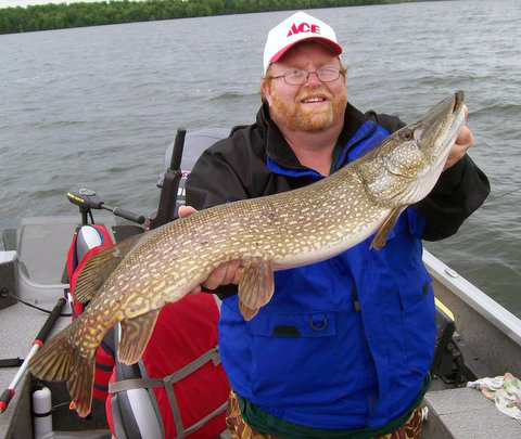 Fishing guide Charlie Worrath with happy northern fishing client