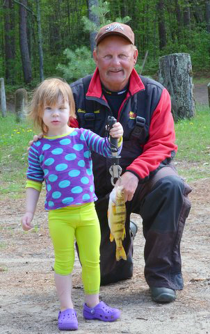Fishing guide Charlie Worrath with young perch fisherman