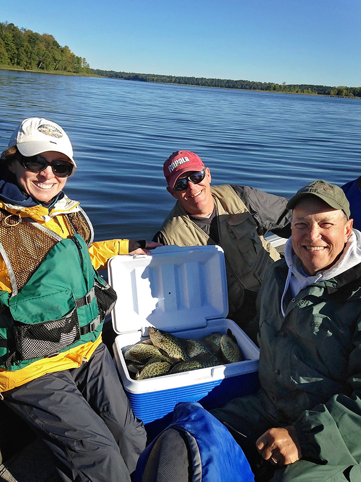 Charlie Worrath clients with a cooler full of crappie