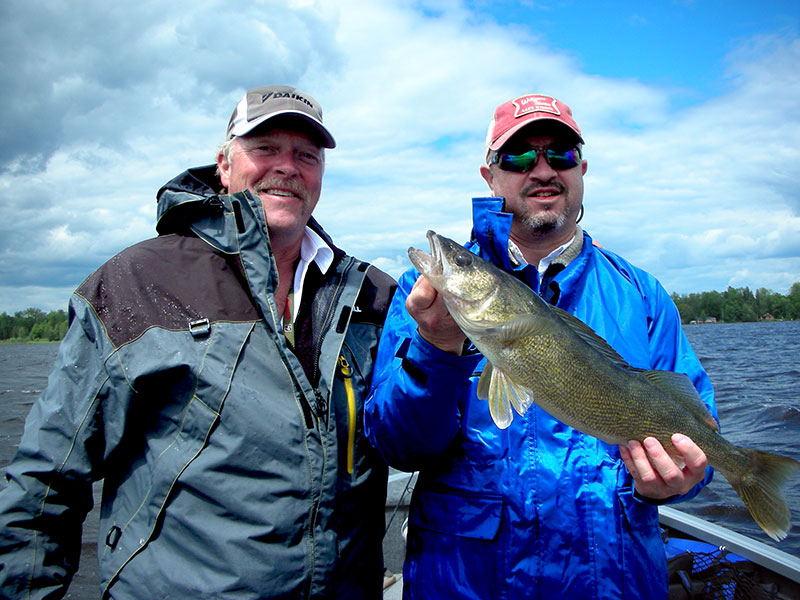 MN Fishing Pro Guide Jason Boser with walleye catch, 2014