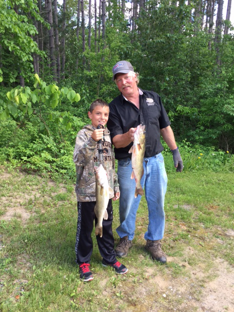 Fishing guide Jason Boser with walleye catch