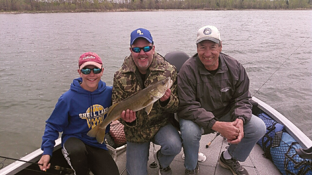 MN Fishing Pro Guide Jason Boser clients with large gorgeous walleye
