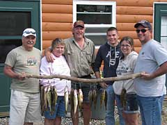 Jason Boser, of Fishing Fever Guide service and MNFishingPros.com, with happy guide clients