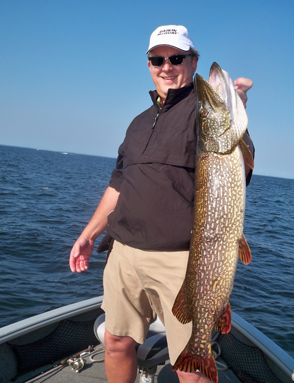 Jeff Skelly client with walleye