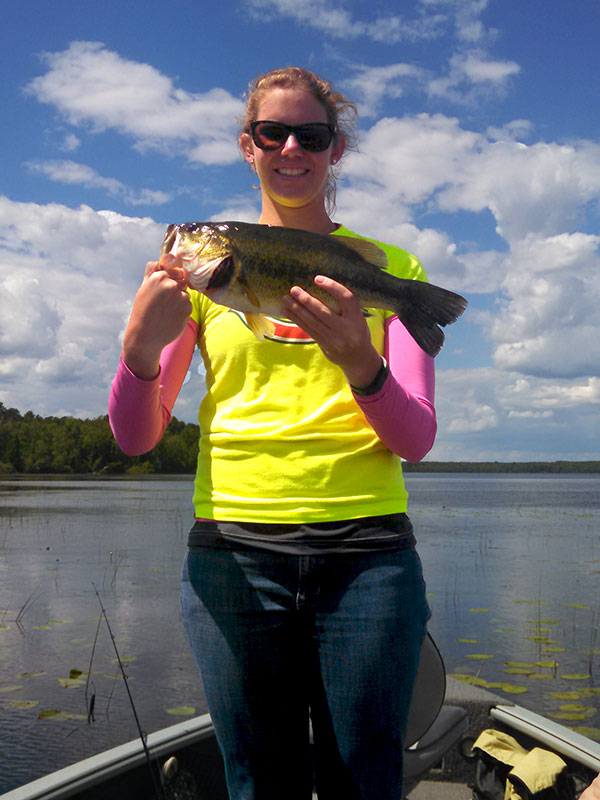 Fishing guide client with large mouth bass