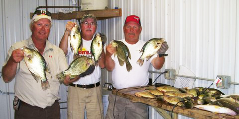 Jeff Skelly, Bill Broberg and Charlie Worrath with their crappie catch