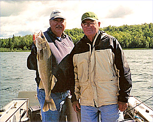 MN Fishing Pro Bill Broberg with client and walleye